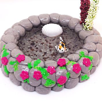 Miniature koi fish pond. Fairy garden accessories, dollhouse, terrarium décor. Shell and pink flowers.