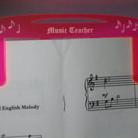 Music teacher music page holder pink fluorescent transparent pink
