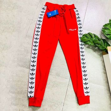 ADIDAS tide brand men and women classic clover string sports trousers Red