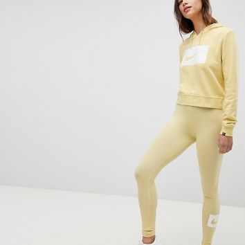 Nike Club Leggings In Lemon at asos.com