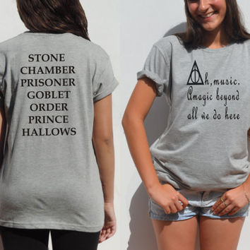Ah, music. A magic beyond all we do here Dumbledore quote t shirt Harry potter fans clothing Deathly hallows unisex tee teens book