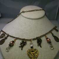 """Brassy Gold Tone Charm Necklace, 22"""", hearts, angels, rose beads, moon & more, 1990's"""