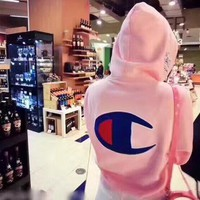 Champion sells a large embroidered logo casual hoodie for women