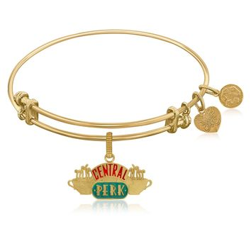 Expandable Bangle in Yellow Tone Brass with Central Perk Symbol