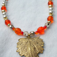 Ancient Wisdom Orange White and Gold Necklace