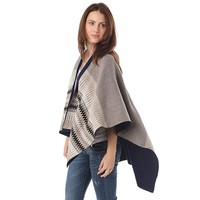 Beige geo-tribal cape in knitted fabric