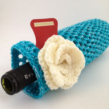 Blue and White Crochet Wine Bottle Cozy with flower and tag