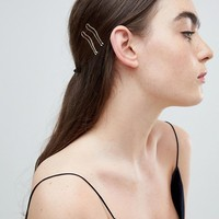 ASOS DESIGN pack of 4 cut out stacking hair grips in gold at asos.com