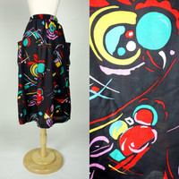 1980s novelty print skirt, patch pocket black high waist tea length atomic cotton elastic waist skirt, Medium to large