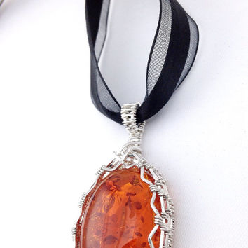 Designer Amber wire wrapped pendant on a ribbon necklace