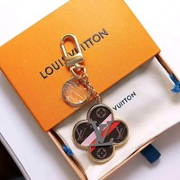 LV tide brand female color matching old flower leather keychain
