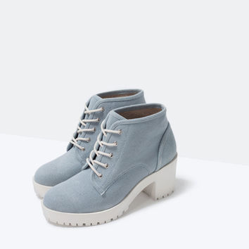 Ankle boot with rubber sole