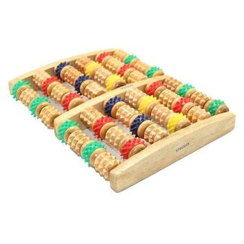 Reflexology Massage In The Wooden Feet Massage Roller
