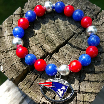 New England Patriots NFL Bracelet. Stretch Bracelet. Pats Logo Football Charm. Red Blue Silver Beads. Handmade. Jewelry.