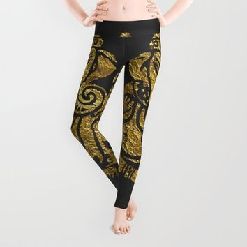 The Lord of Success Leggings by Haroulita | Society6