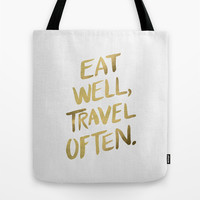 Eat Well Travel Often on Gold Tote Bag by Cat Coquillette