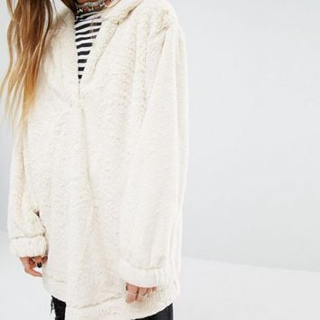 Reclaimed Vintage Oversized Fur Hoodie With Placket Detail at asos.com