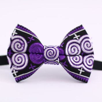A handcrafted bow tie made from Hmong fabric (paj ntuab).