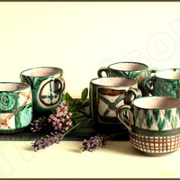 Set of six small cups, modernist studio pottery by Robert Picault. Vallauris, France. Mid century, 1950s.
