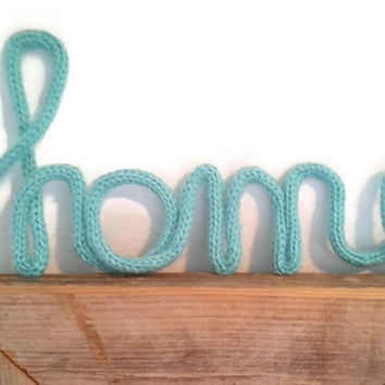 Knitted word, yarn word or wire word.  Any word is possible (custom order)