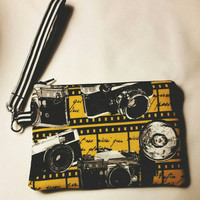 Wristlet, zipper pouch, phone pouch in a beautiful camera pattern.