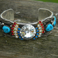 Antique Solid sterling turquoise cuff bracelet .Signed T.H. Vintage Sleeping Beauty Turquoise.red ,Clear and blue stone earring accents. WOW