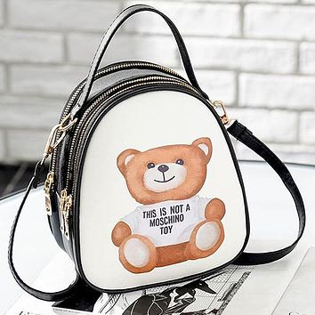 Moschino Intimate headphone jack Bag Backpack Bag Handbag Shoulder bag School Bag Phone Bag (One package three ways to use)