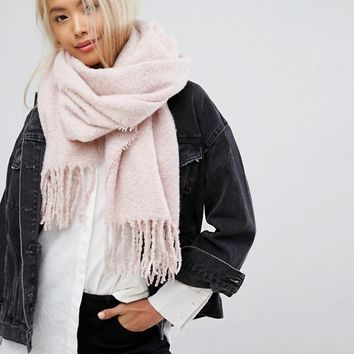 Stitch & Pieces Boucle Knitted Scarf with Tassles in Blush Pink at asos.com