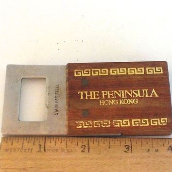 Vintage Bottle Opener Souvenir From The Peninsula Hong Kong Wood And Stainless Steel Some Light Wear 3 And 7/8 Inches X 1 And 3/4 Inches