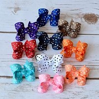 2 inch swiss dot boutique style hair bows. Small hairbows for baby girls, toddlers and little girls. Your Final Touch Hair Accessories