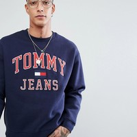 Tommy Jeans 90's Capsule Logo Sweatshirt in Navy at asos.com