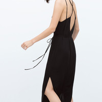 Long dress with cross-over straps