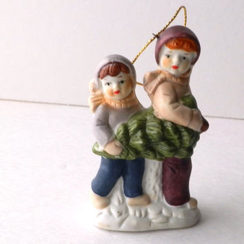 Brothers Carrying a Christmas Tree Porcelain Ornament