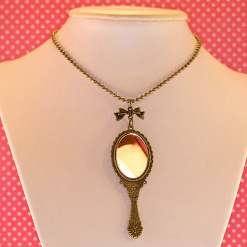 Bronze pendant with glass mirror, necklace with chain and bow