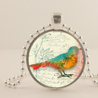 Teal bird and orange with tree, glass and metal Pendant necklace Jewelry.