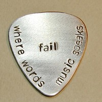 Stamped aluminum guitar pick where words fail music speaks - above 15 characters