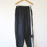 Vtg '90s Black NIKE SWOOSH Nylon Athletic Stripe Ankle Zip JOGGER Pants Sz L