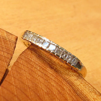 A vintage 9k yellow gold 1/2 carat diamond ring.