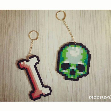 set of 2 pixel art plastic hand made skull & bone key chains/ bag charms