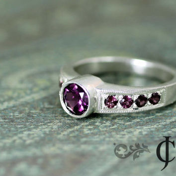 Rhodolite Garnet Ring in Sterling Silver and features 9 - rhodolite stones in a rose to lavander color