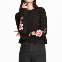 Jersey top with embroidery - Black/Flowers - | H&M GB