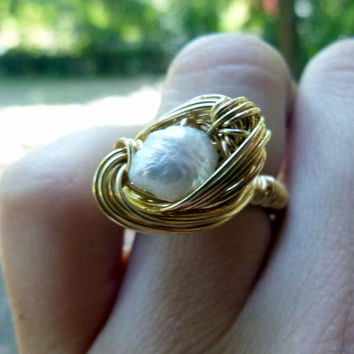 white fresh water pearl ring , nested in nugold wire , wire wrapped jewelry , gold ring , statement art , brass jewelry , ooak jewelry