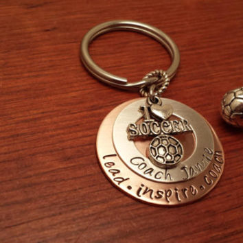 "Hand stamped soccer coach's key chain with saying. ""lead, inspire, coach"""