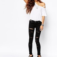 Liquor & Poker Low Rise Skinny Jeans With All Over Rips Shredded at asos.com
