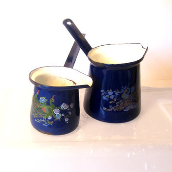 Coffee pot. Enamelware. Enamel pot. Two cobalt blue turkish coffee pots with peacock design. Rusty metal. Middle eastern. Vintage.