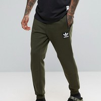 adidas Originals Brand Pack Joggers In Green AY9302 at asos.com