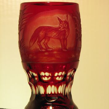 910256 Ruby Cased Glass With Deep Engraved Fox In Oval Panel, Trees Around 3 Rows Of Oval Cuts On Stem & Base