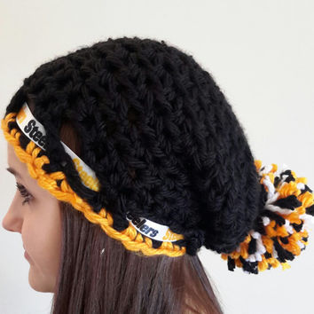crochet Steelers inspired hat. with pom pom. Made by Bead Gs on Etsy. Black and gold. Ladies size.