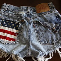 High waisted denim short with flag and studs.