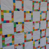 Modern and simple square ring patchwork quilt in bright and colorful fabrics. Great mother's day or graduation gift.